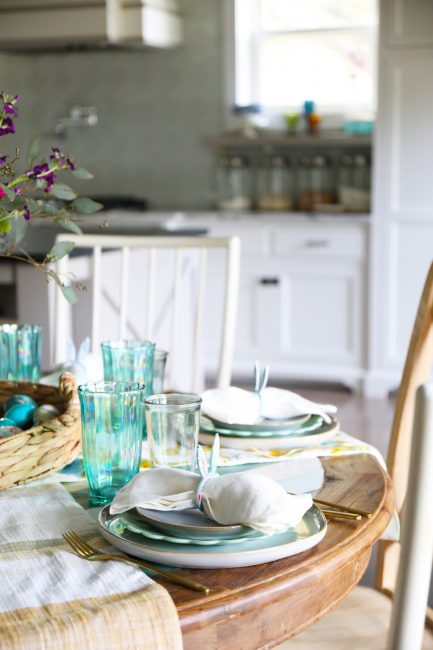 Solid white table background with accents of turquoise and bunny ear napkin rings