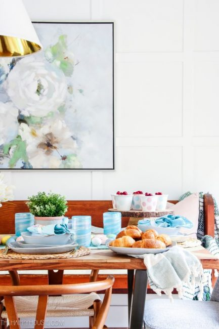 wooden table with bright blue and pink accents of Easter decor