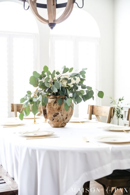 White Table Setting with Green Plant as the centerpiece