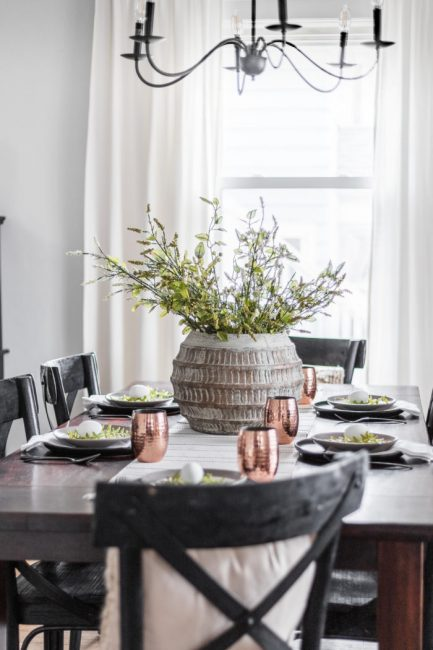 Easter Table setting featuring simple solid dishes and copper cups to accent