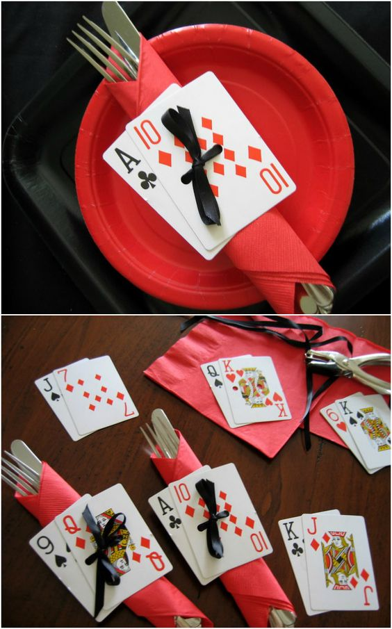 Deck of cards DIY napkin rings on a red plate for casino party or game night.