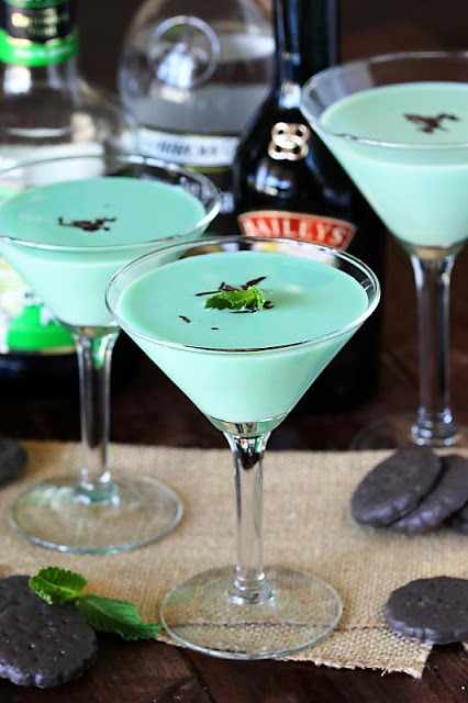 St. Patrick's Day drink featuring Bailey's Irish Cream, green food coloring, and mint on top.