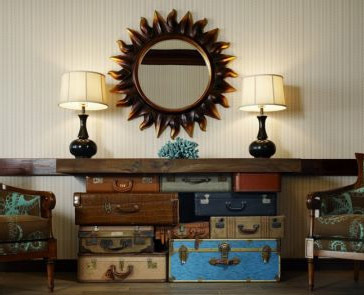 Vintage Suitcase Sofa Table included in these 20 DIY Vintage Suitcase  Projects and Repurposed Suitcases.
