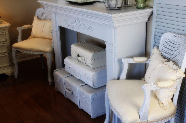 Vintage Suitcase Fireplace Decor included in these 20 DIY Vintage Suitcase Projects and Repurposed Suitcases. Create unique home decor using repurposed old suitcases!   OHMY-CREATIVE.COM
