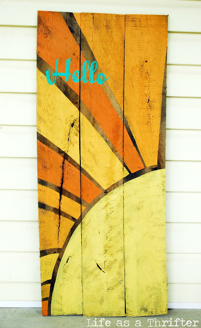 This colorful Sunshine DIY Pallet Sign Art is a perfect easy pallet repurposing project. Display it on the front porch, patio or as decor in the home!