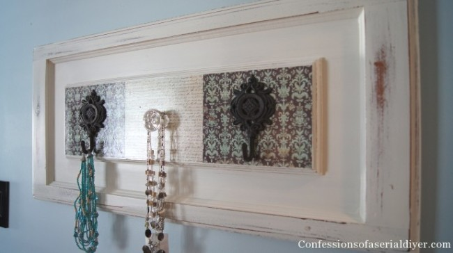 Cabinet door repurposed into decorative wall hooks