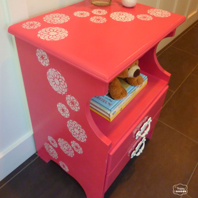 coral-pink-nightstand-with-sweeping-stenciled-flowers-angled-thumbnail-at-thehappyhousie-1024x1024