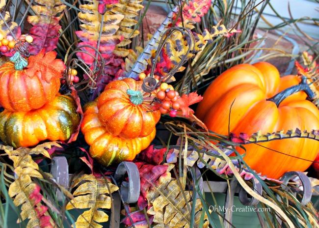 fall pumpkins in a window box