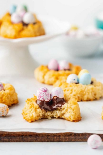 Cookies made into the shape of nests with chocolate and egg hard candy in the middle