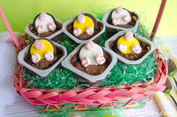 Easter themed pudding cups with Oreo cookies, graham crackers, and icing.