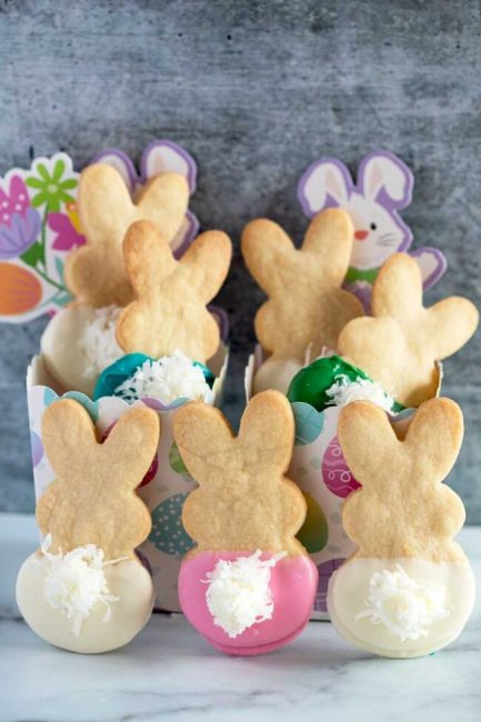 Shortbread Cookies cut into the shape of Easter bunnies and colored bottom halves with coconut flake tails
