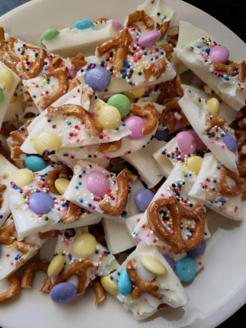 Sweet and salty snack featuring pretzels, M&M candy, chocolate, and sprinkles