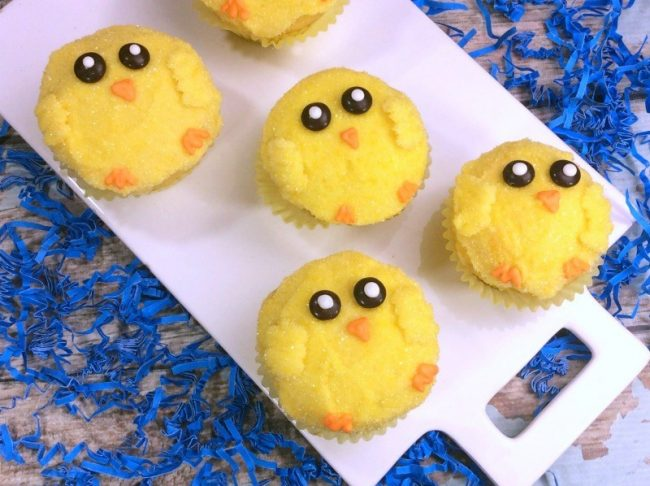 Easter Cupcakes in the shape and look of baby chicks featuring yellow bodies and small chocolate eyes