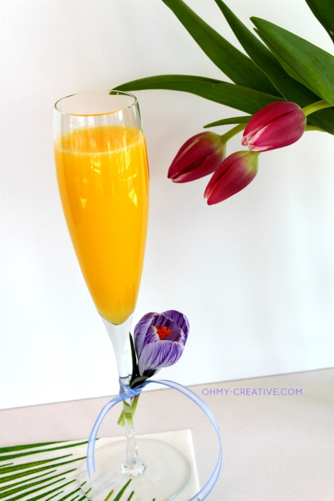 Serve a Non Alcoholic Mimosa Mocktail for a baby shower     OHMY-CREATIVE.COM