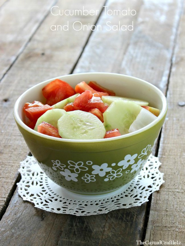 A bowl of cucumber tomato and onion salad