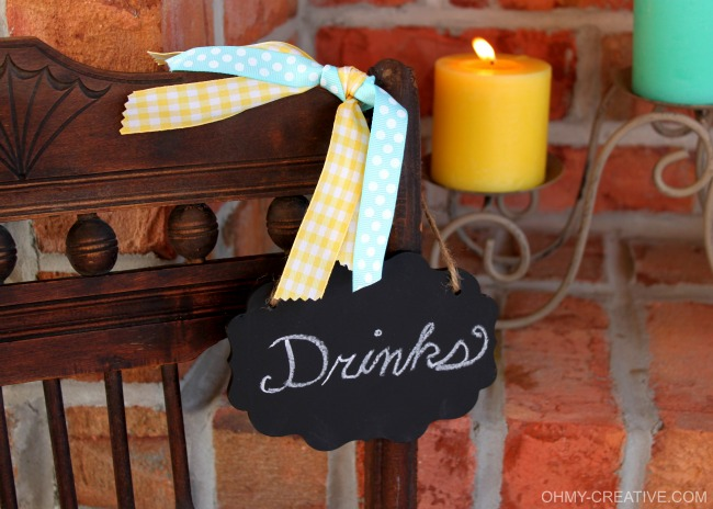 Repurpose an old vintage chair into a pretty drink stand using a chalkboard sign! Perfect for entertaining, parties or bridal showers!
