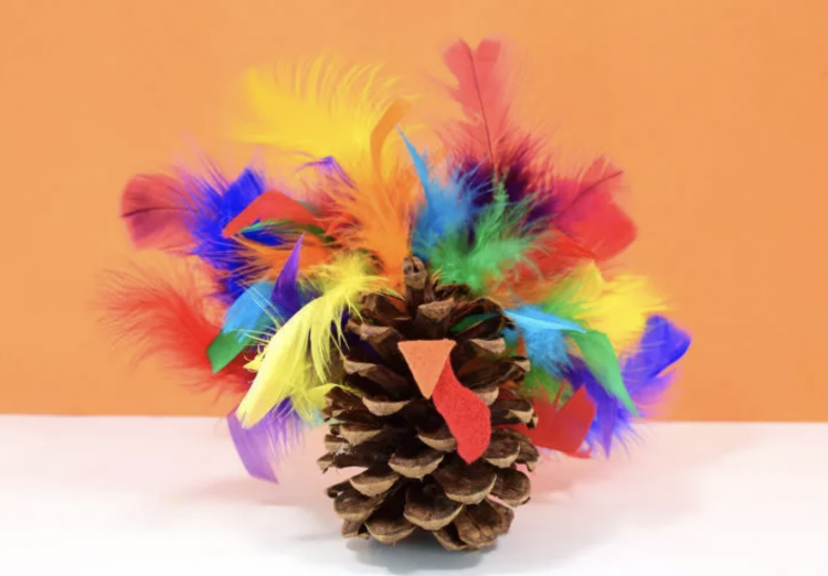 bright feather and pinecones makes this turkey craft fun for the kids
