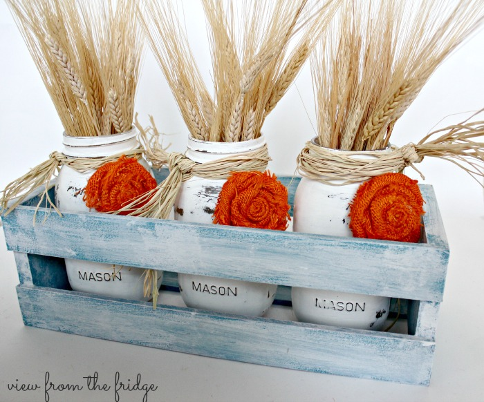 Easy fall DIY decor idea ... distressed mason jars and burlap rosettes