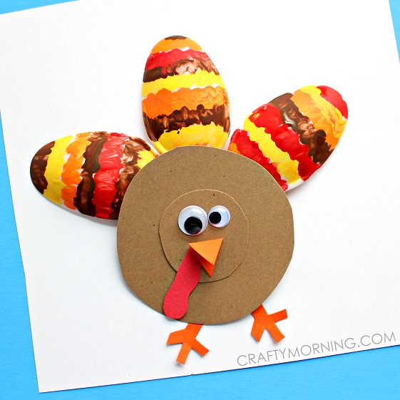 Painted plastic spoons and construction paper are a fun way to make this turkey craft