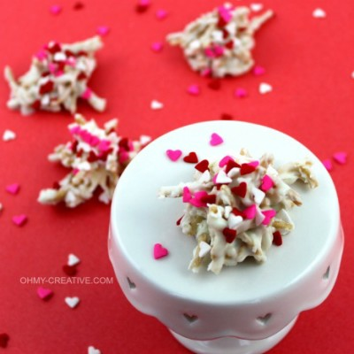 A cute Valentine's twist on a favorite cookie! White Chocolate Valentine Haystacks Cookies | OHMY-CREATIVE.COM