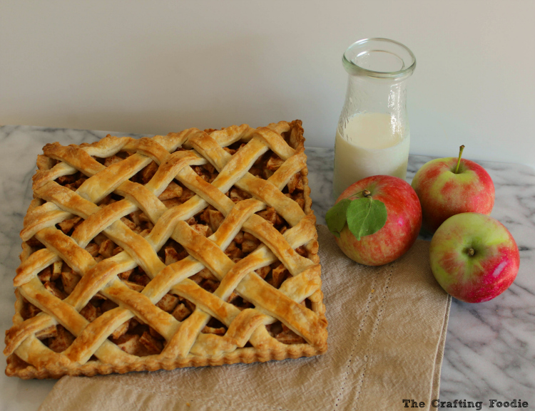 This Apple Tart is made with a flaky, all-butter crust that envelopes juicy honey crisp apples that are spiced with cinnamon, nutmeg and a touch of sugar.