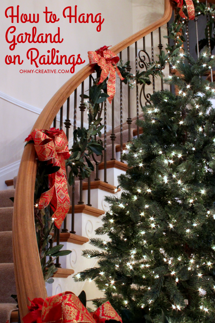 how to hang garland on staircase banisters oh my creative. Black Bedroom Furniture Sets. Home Design Ideas