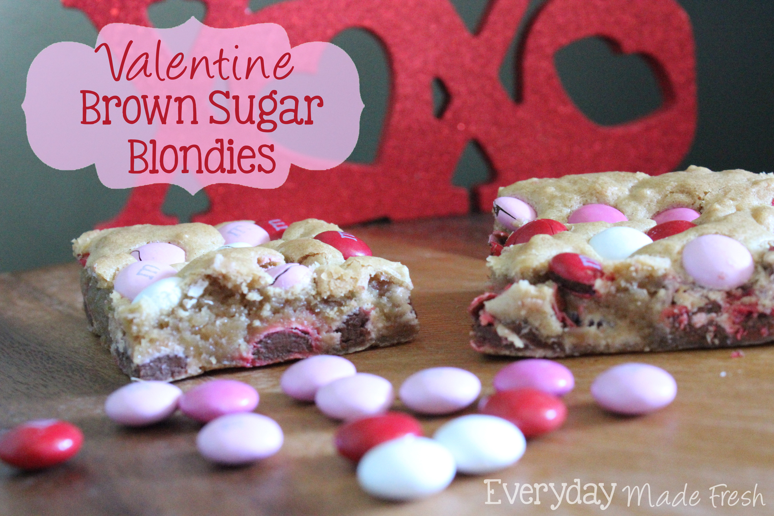 Brown Sugar Blondies are the perfect treat to serve up on Valentine's Day or any day! Soft warm hints of brown sugar and vanilla, with a pop of color from the M&M's. | OHMY-CREATIVE.COM via EverydayMadeFresh.com