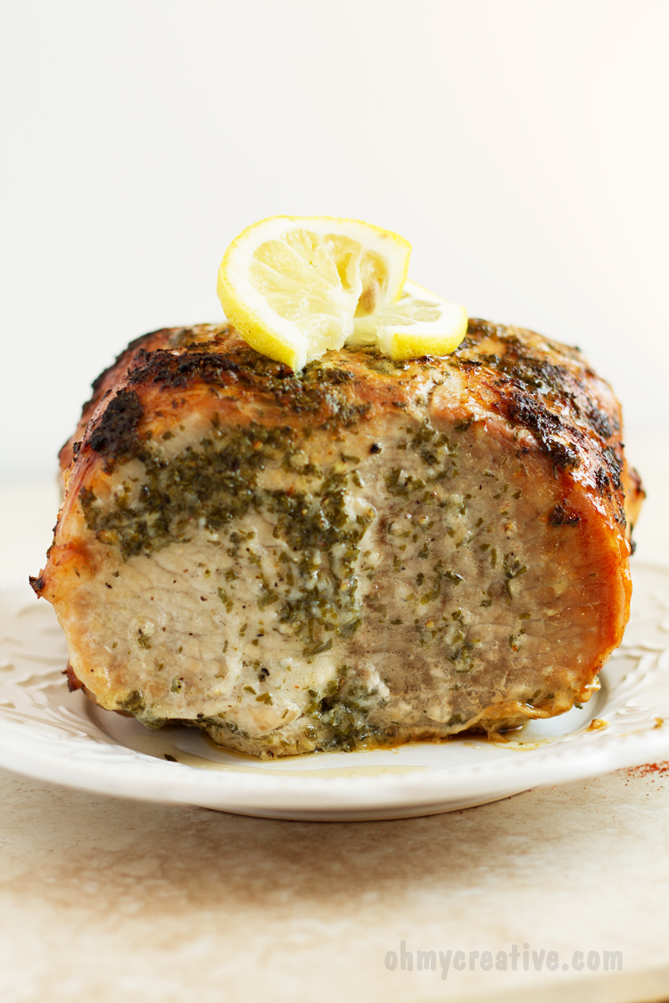 Lemon Marinated Pork Tenderloin Recipe - marinated with lemon and parsley and baked in the oven. This tender and juicy pork is an easy recipe to prepare for dinner with ingredients that you have at home. | WWW.OHMY-CREATIVE.COM
