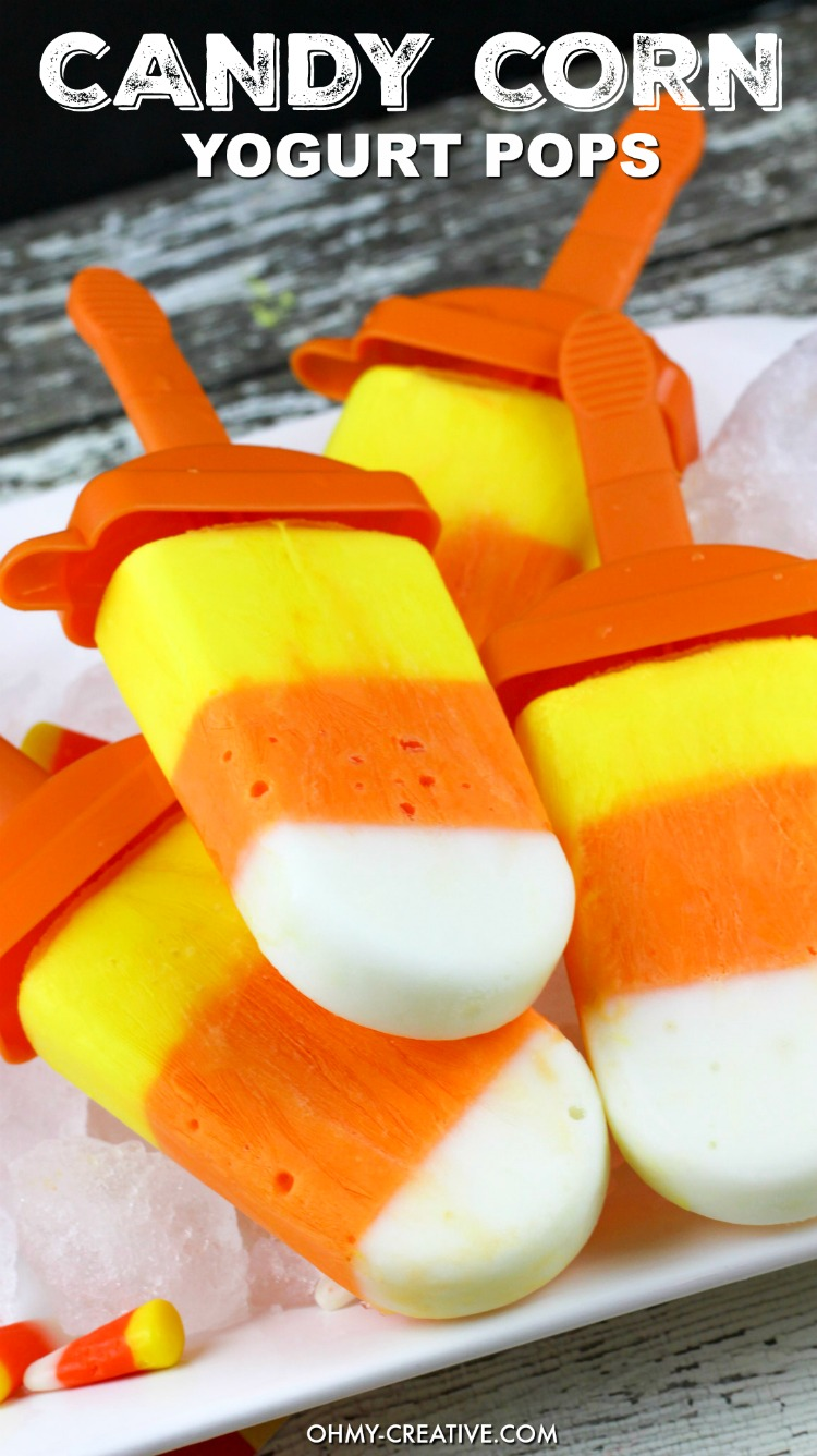 Yogurt Candy Corn Pops! Yellow, orange and white - those infinite colors are a sure sign that Fall and Halloween are on the way! An easy to make Homemade popsicle Recipe that is fun to eat. What a great Halloween kids treat! Popular pins by OHMY-CREATIVE.COM
