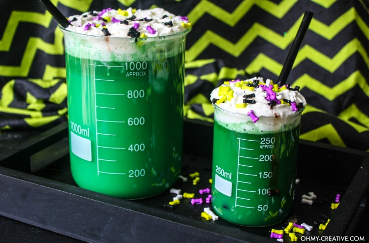 These Mad Scientist Halloween Kids Drinks served in a beaker is a spooktacular party drink! A fun green drink for kids at Halloween or for a Mad Scientist Party! | OHMY-CREATIVE.COM