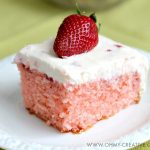 This Strawberry Cake With Whipped Cream Cheese Frosting is bursting with fresh strawberry flavor. A perfect dessert for any occasion spring or summer. OHMY-CREATIVE.COM   strawberry sheet cake   strawberry cake from scratch   homemade strawberry cake   fresh strawberry cake   whipped cream cheese frosting   spring dessert   summer dessert   dessert recipe   fresh strawberries   sheet cake recipe  