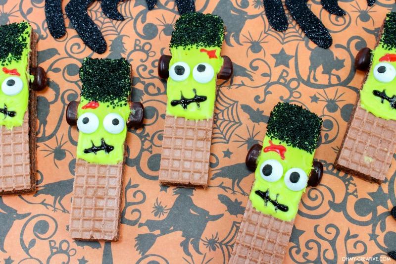Five finished Frankenstein Cookies on Halloween background