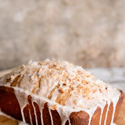 This coconut pound cake is an easy sweet bread for beginning bakers. Learn how to toast coconut and make a rich pound cake from scratch. A delicious glazed pound cake for any occasion!