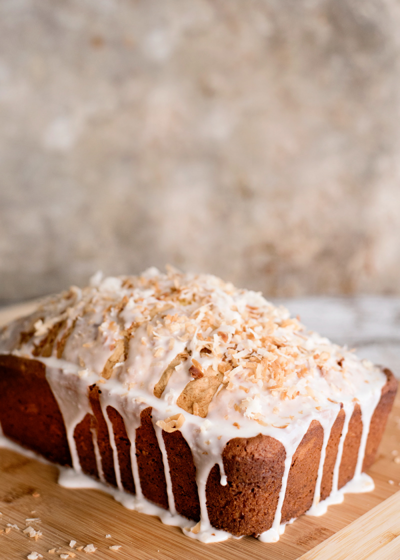 Toasted Coconut Pound Cake Recipe is dripping with a delicious glaze topped with toasted coconut.