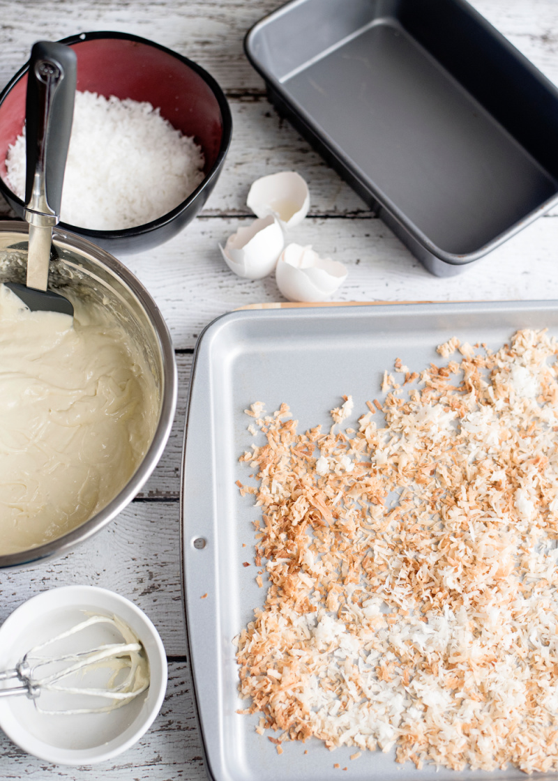 Toasted coconut on a sheet pan and batter for a pound cake