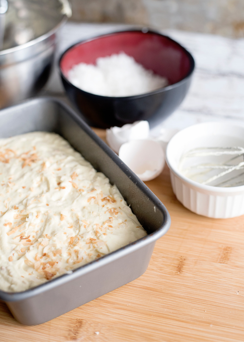 Once the batter is evenly spread in the loaf pan, it is ready to go into the oven.