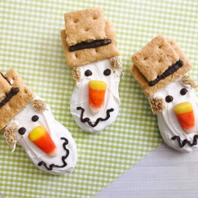Look at our cute Scarecrow Nutter Butter Fall Cookies complete with candy corn nose and wiggly smile