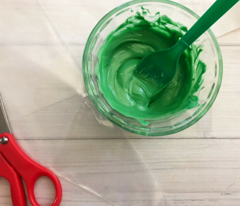 Melted green candy melts for Indian Corn Harvest Cookies idea. Harvest Indian Corn Cookies are a perfect treat to serve at any fall celebration or Thanksgiving! OHMY-CREATIVE.COM | Fall Cookies | Indian Corn | Fall Desserts | Cookie Pops | Nutter Butter Cookies | #indiancorn #indiancorncookies #falldessets #fallcookies #harvestcookies