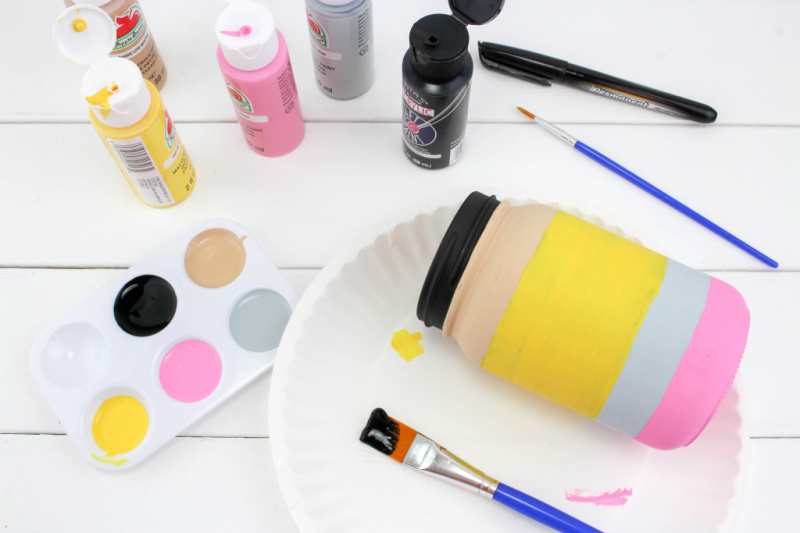 Paint tan and black stripe at the top of the pencil mason jar craft