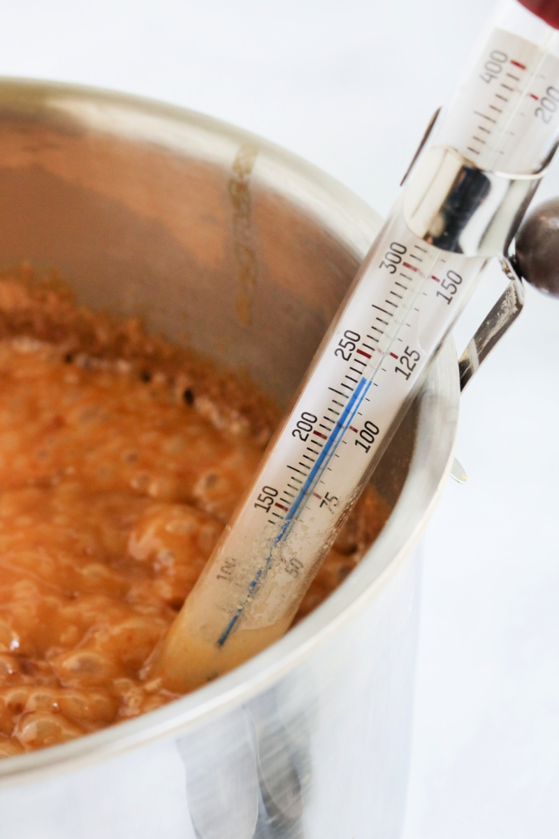 caramel sauce on stove with candy thermometer in pot