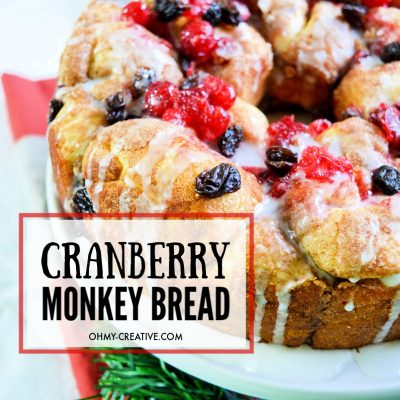 baked cranberry raisin monkey bread on a white plate