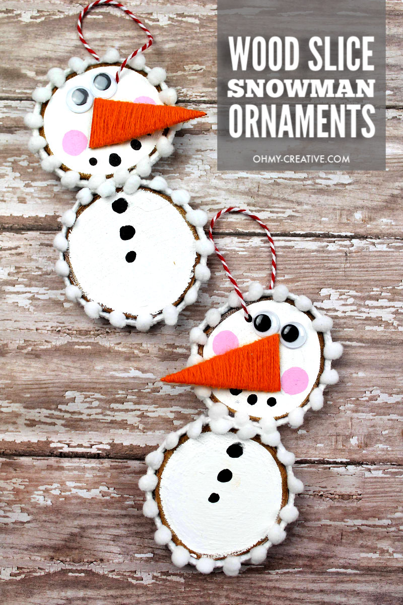 finished wood slice snowman ornament on a wood background