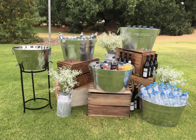 Backyard party drink station using wood crates and galvanized drink buckets