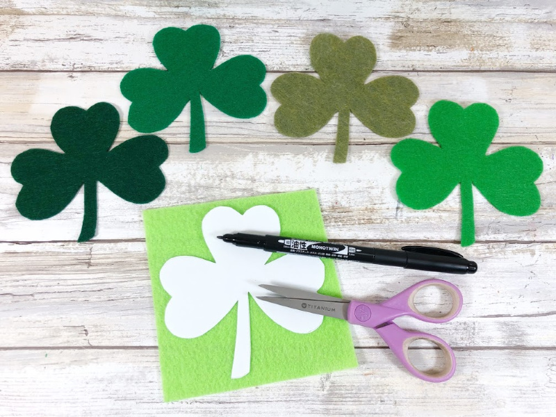 Download, print and cut out Shamrock shapes from the Pattern Shee Trace onto green craft felt with a permanent marker.