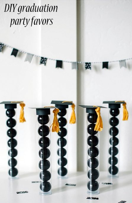 These graduation party favors have classic black and gold colors. They look gorgeous in their monochromatic glory. You'll need to get some black gumballs for them and follow the easy instructions to make the grad hats.