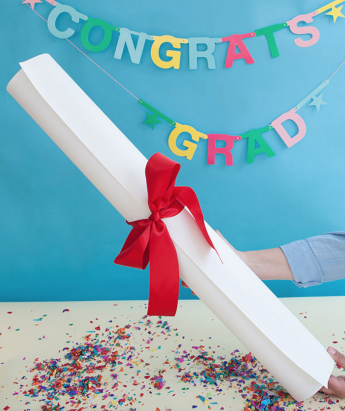A giant diploma filled with little gifts is the most fun way to give a gift to your graduate! It looks cute, it's fun to unwrap, and you can fill it with so many fun things.