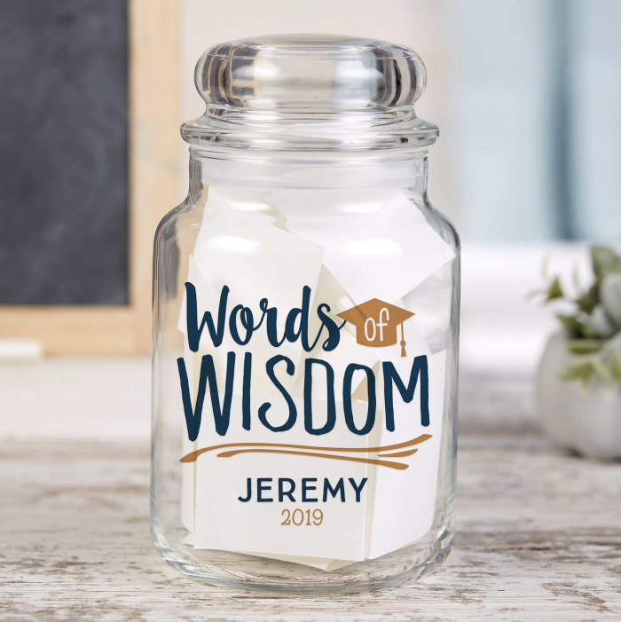 """A jar that says """"Words of Wisdom"""" Set this out and ask guests to fill out their favorite memories of your graduate. This is a special way to share how much they are loved."""