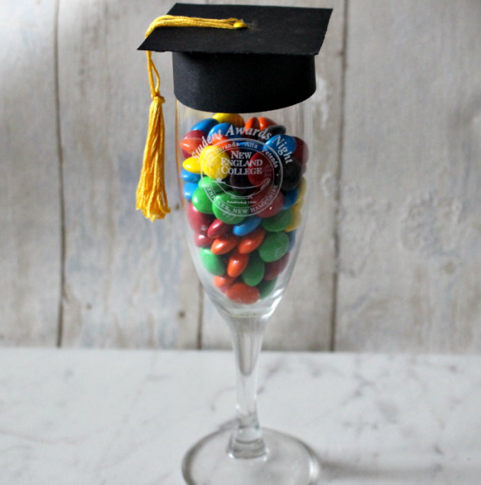 These champagne glasses are filled with candy and topped with a little graduation cap. They are cute! And you can make them even better by using glasses with the logo of your graduate's upcoming college.