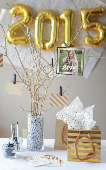 This is a simple centerpiece that is also a fun activity for people during the party. Set out papers and let people leave their best advice for the graduate.