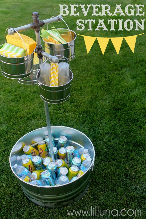 Diy outside beverage station made of galvanized buckets and galvanized pipe.